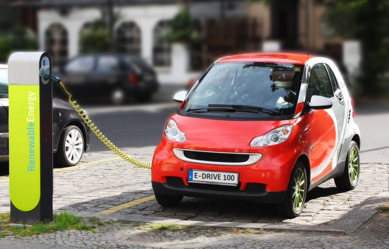 A parked electric vehicle is recharged by an charge point
